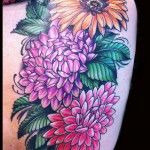 flower - floral Backpiece mums dahlia sunflower tattoo done by female tattoo artist Jessi Lawson