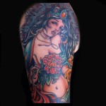green taro god full sleeve tattoo colorful done by female tattoo artist Jessi Lawson