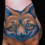 red Fox Hand Tattoo done by female tattoo artist Jessi Lawson