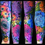 a femanine floral full sleeve tattoo done by female tattoo artist Jessi Lawson