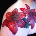 red lily tattoo floral chest piece done by female tattoo artist Jessi Lawson